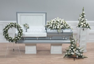 Purity Casket Spray, all white flower sympathy arrangement.
