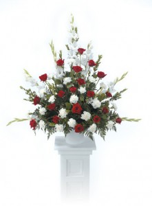 Large arrangement of Roses, Carnations and Gladiolus.