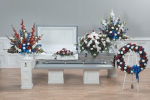 Honor Tribute with red, white and blue flowers features striking blue delphinium