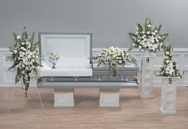 innocence all white funeral flower arrangement with beautiful orchids
