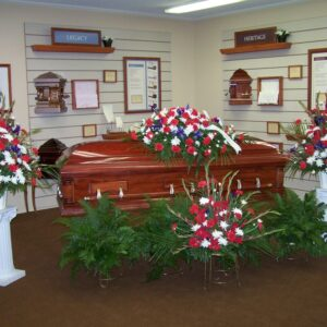 Traditional red, white and blue funeral tribute